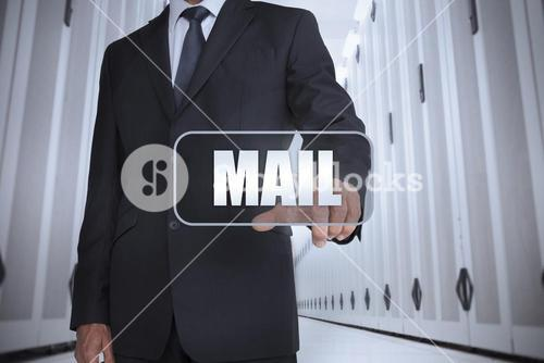 Businessman in a data center selecting label with mail