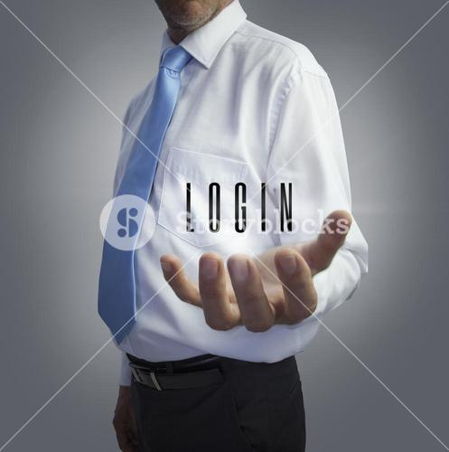 Businessman holding the word login