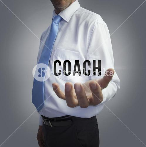 Businessman holding the word coach