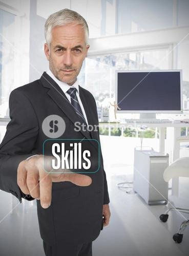 Businessman selecting the word skills