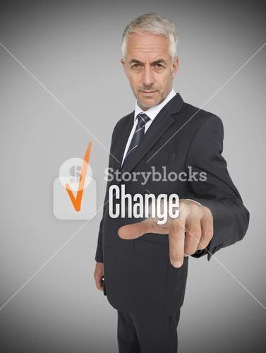 Businessman selecting the word change