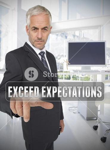 Businessman touching the term exceed expectations