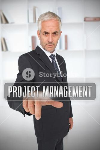 Serious businessman touching the term project management
