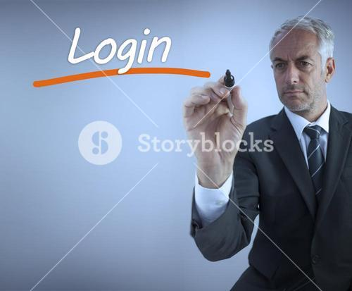 Businessman writing the word login