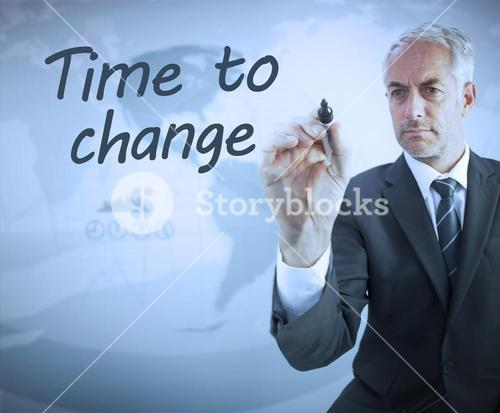 Businessman writing time to change