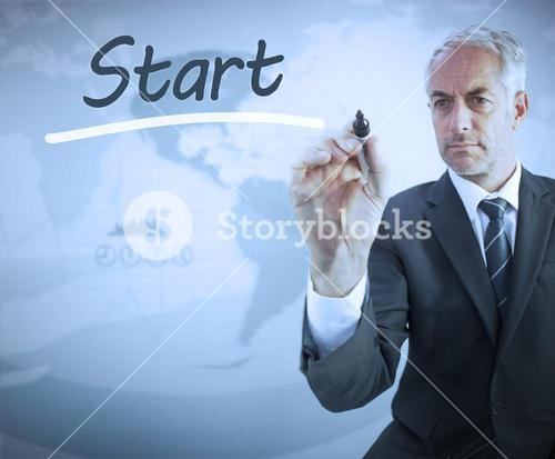 Businessman writing the word start