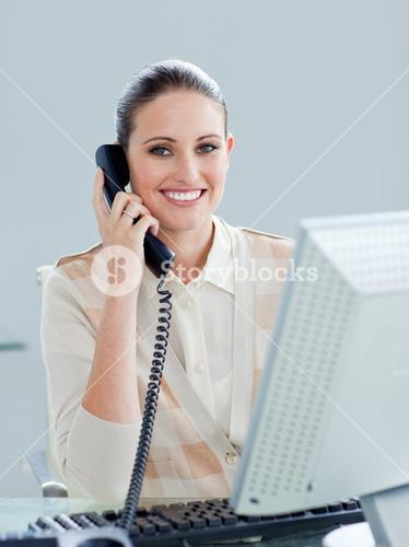 Enthusiastic businesswoman talking on phone