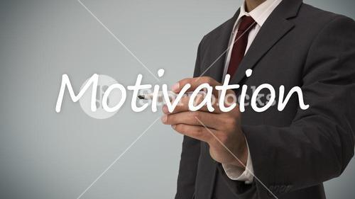 Businessman writing the word motivation