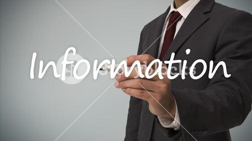 Businessman writing the word information