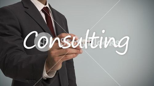 Businessman writing the word consulting with a marker