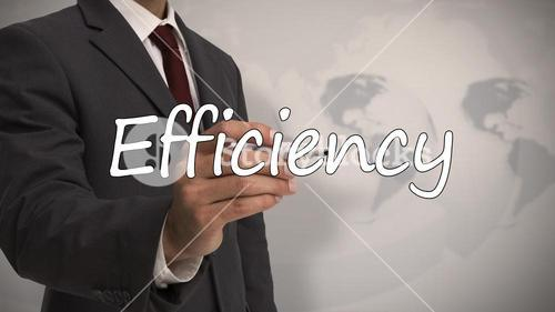 Businessman writing the word efficiency