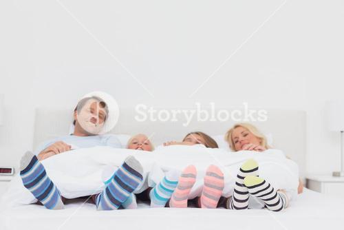 Family wearing stripey socks