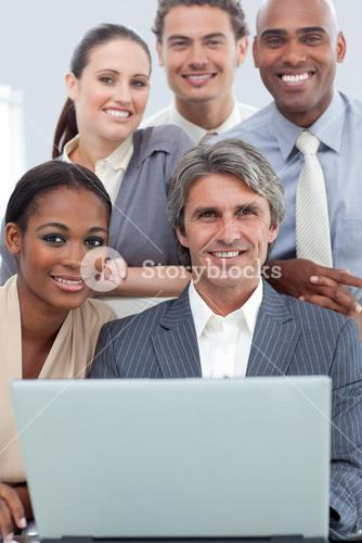 A diverse business team working at a laptop