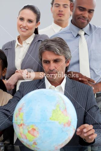 Business people around a terrestrial globe