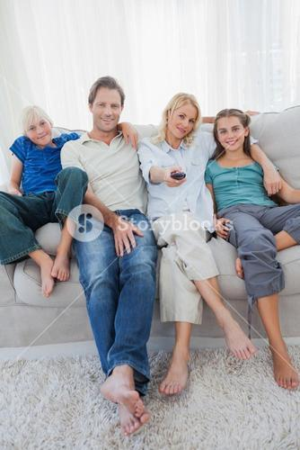 Portrait of a family watching television
