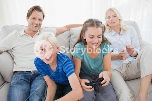 Children playing video games on the couch