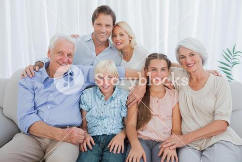 Extended family smiling at camera