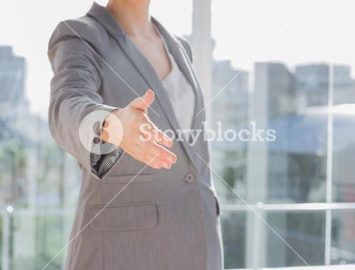 Businesswomans hand reaching out