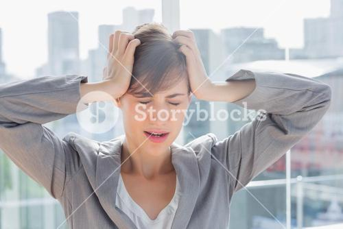 Frustrated businesswoman with hands on head