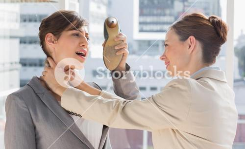 Businesswoman defending herself from her colleague strangling her