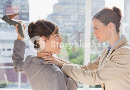 Businesswoman defending herself from her co worker strangling her