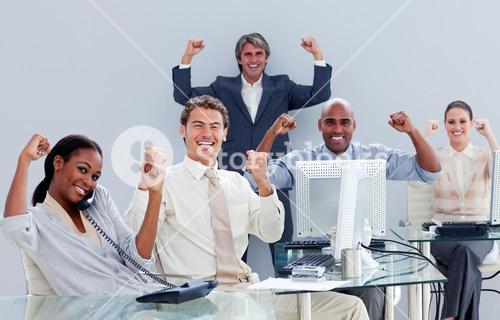 Victorious business team celebrating a success