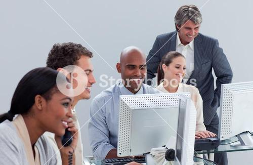 Confident business team at work