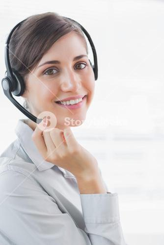 Call centre agent smiling at the camera