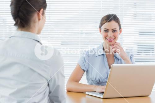 Businesswoman smiling at camera during an interview