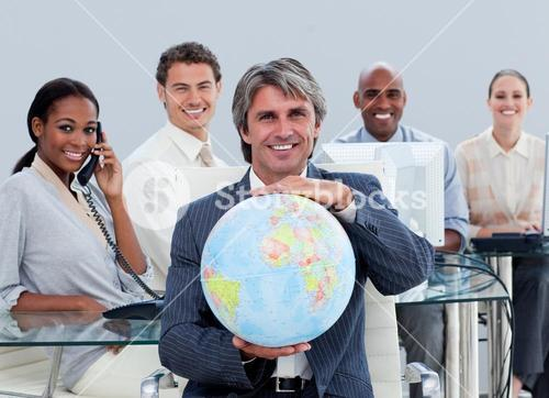 Fortunate business team at work showing a terrestrial globe