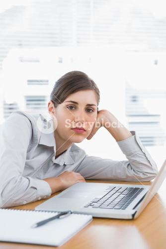 Fed up businesswoman looking at camera