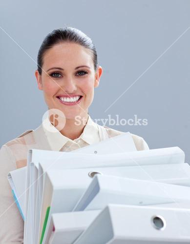 Charming businesswoman carrying folders