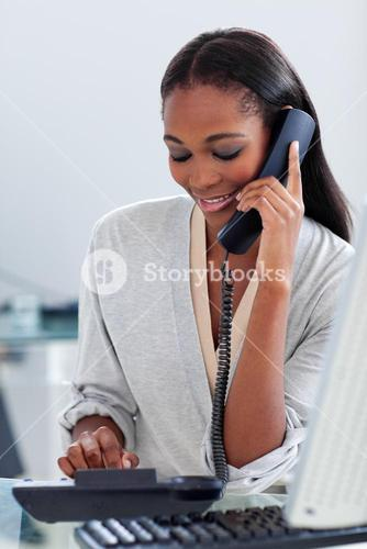 Assertive businesswoman talking on a phone