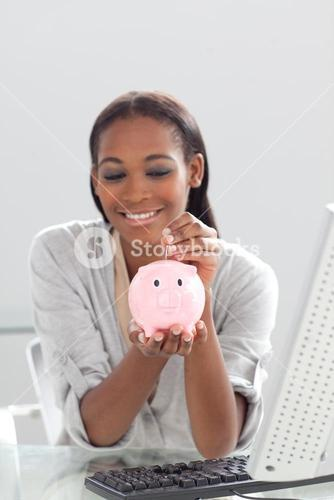 Businesswoman saving money in a piggybank