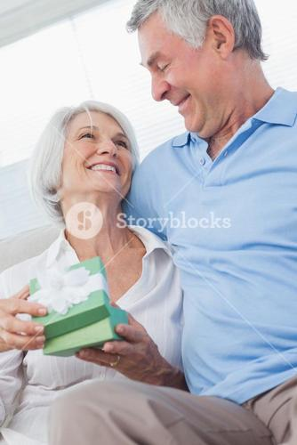 Husband giving a gift to wife