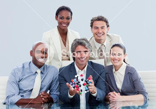 Ambitious business team showing a molecule