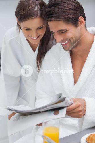 Lovely couple reading newspaper