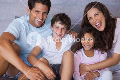 Parents and children smiling at camera