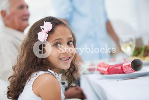 Little girl sitting at table for christmas dinner