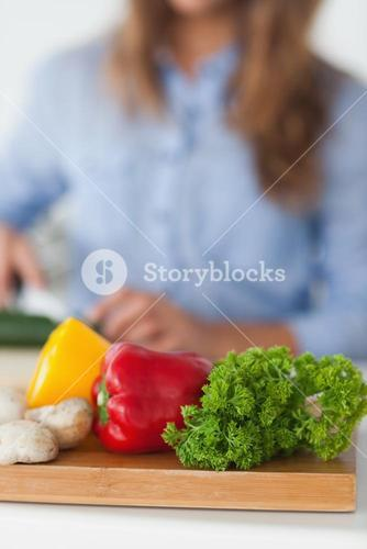 Chopping board with vegetables on a table
