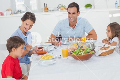 Family eating pasta and salad