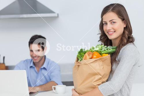 Woman holding groceries bag