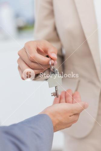 Estate agent giving house key