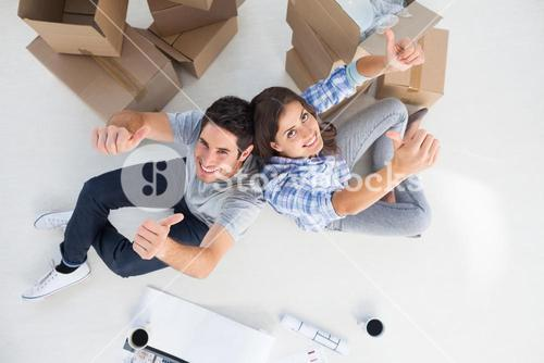 Overview of couple giving thumbs up