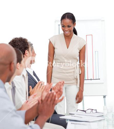 Cheerful business group applauding a presentation