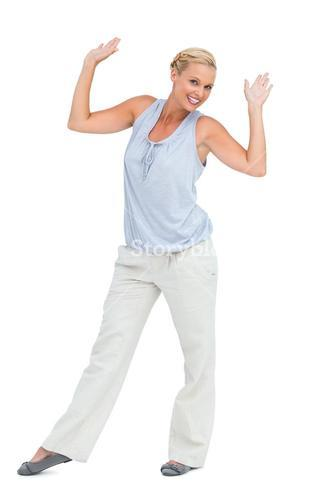 Woman looking and raising hands