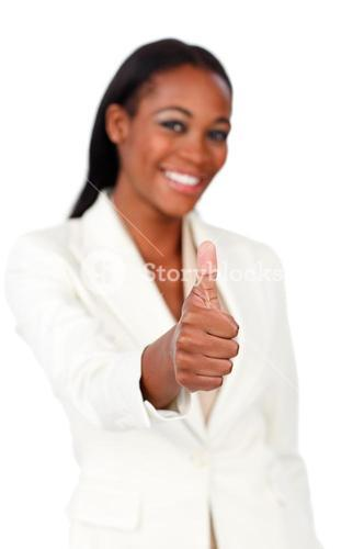 Smiling businesswoman with thumb up