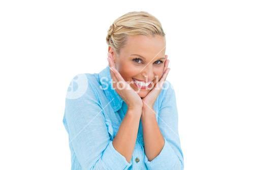 Pretty woman laughing with hands on face