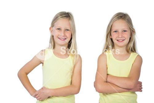 Smiling girls with arms crossed