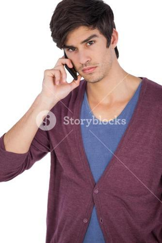 Upset young man with mobile phone